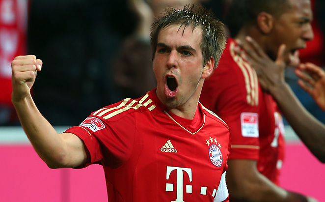 Phillip Lahm celebrates after Bayern Munich took a 3-2 lead over Fortuna Dusseldorf on Saturday.