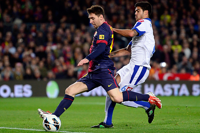 Lionel Messi passes Deportivo Coruna's Aythami Artiles en route to his goal in Barcelona's 2-0 win.