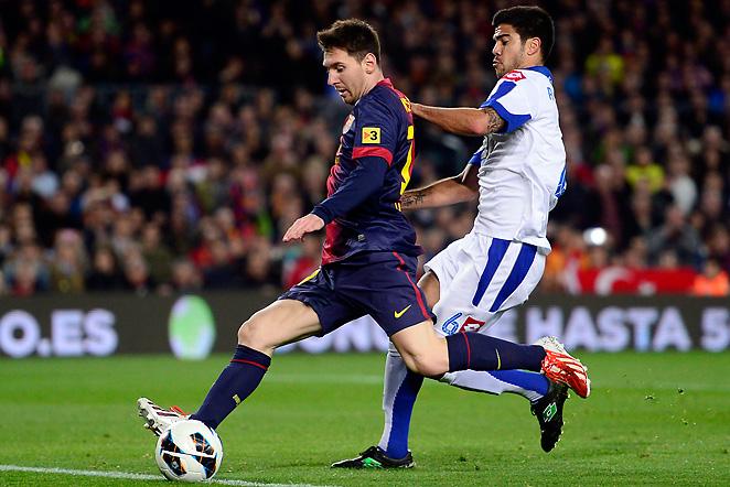 Lionel Messi passes Deportivo Coruna's Aythami Artiles en route to his goal in Barcelona's 2-0 win.