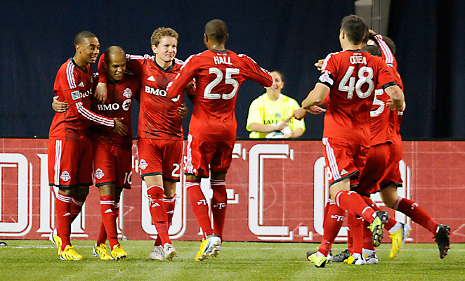 Toronto FC players celebrate one of two goals from on-loan striker Robert Earnshaw, second from left.