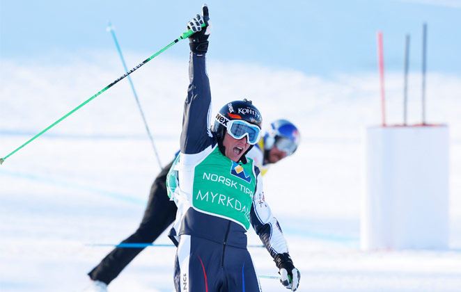 Jean Frederic Chapui of France celebrates winning the ski cross world title.