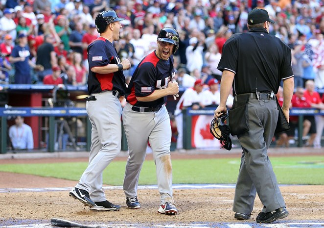 David Wright celebrates after scoring during the eighth inning of Team USA's win over Canada.