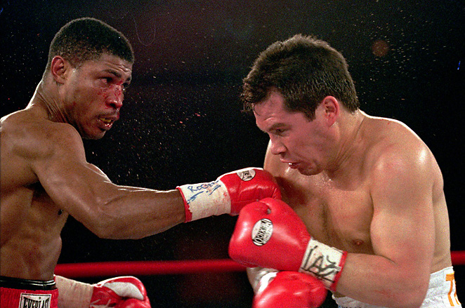 Tony Martin, left, lost to Julio Cesar Chavez in his final career fight. Martin was fatally shot on Friday.