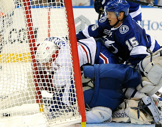 Montreal Canadiens right winger Brendan Gallagher and goaltender Cedrick Desjardins and defenseman Brian Lee of the Tampa Bay Lightning collide as Gallagher scores in the third period of the March 9 contest. Gallagher's goal with just less than eight minutes remaining carried the Canadiens to a 4-3 victory.