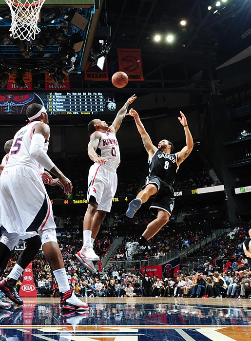 Brooklyn Nets point guard Deron Williams gets off a tough fadeaway jumper over the outstretched arm of Atlanta Hawks point guard Jeff Teague on March 9. Williams contributed 17 points and six assists as the Nets picked up a road win over the Hawks 93-80, their third straight victory.