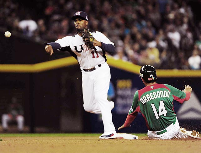 Shortstop Jimmy Rollins steps on the bag and fires to first to try to turn a double play in the third inning of the United States' game against Mexico in the World Baseball Classic on March 8. Ramiro Pena beat out the throw, and Mexico scored twice in the inning, doubling its lead to 4-0 in a 5-2 victory. The United States still won its pool, beating Italy and Canada to advance to the second round.