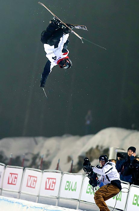 Thomas Krief soars above the half pipe at the Tryvann Winter Park in Oslo, Norway in the FIS Freestyle World Ski Championships. Krief scored a 94.2 on his run to earn third place in the half pipe competition.