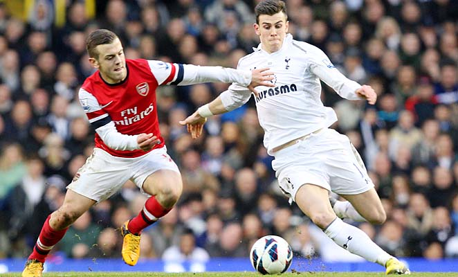 Jack Wilshere (left) challenges Gareth Bale in a Premier League match last week.