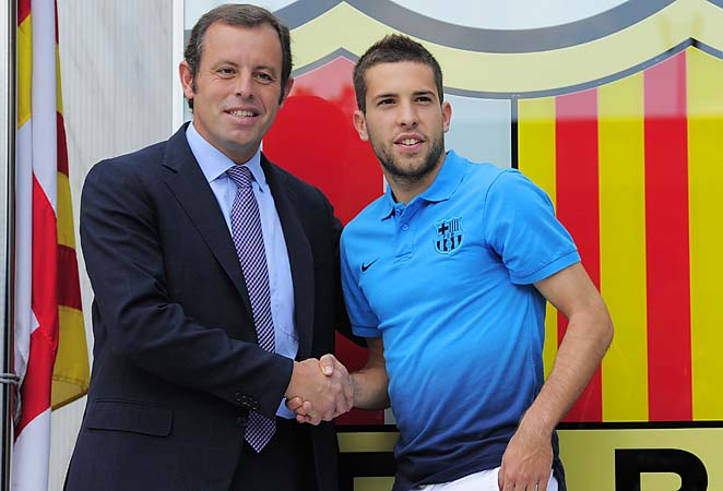 Sandro Rosell (left) shakes hands with Jordi Alba upon Alba joining Barcelona last year.