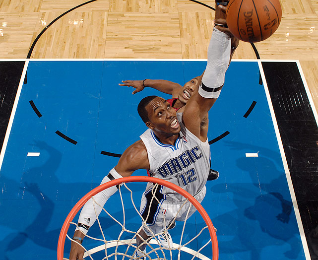 "After months of trade speculation, Howard shocked everyone when he opted into the final year of his contract with the Magic. ""I'm loyal. I talked to my teammates and told them, 'I'm all in,' "" Howard said at a news conference announcing the decision. But Howard wasn't that loyal; he refused to sign a long-term extension, saying only, ""This is where I am today."""