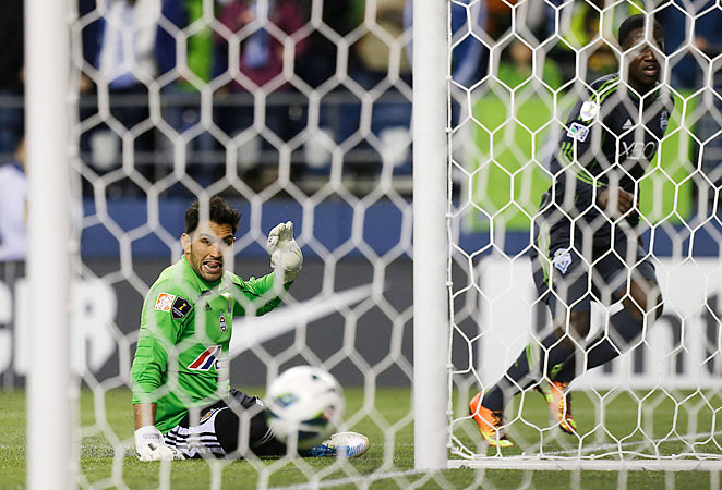 Tigres goalkeeper Jorge Diaz de León looks back in dismay as Sounders striker Eddie Johnson celebrates scoring the winning goal in the teams' CONCACAF Champions League quarterfinal tie.