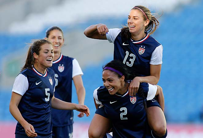 Alex Morgan celebrates on the shoulders of Sydney Leroux after scoring the opening goal.