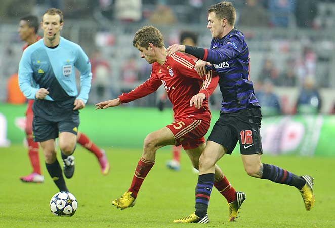 Thomas Mueller's (red) Bayern Munich joined Borussia Dortmund as German clubs in the quarterfinals.
