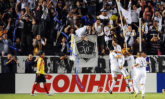 The Los Angeles Galaxy celebrate Omar Gonzalez's opening goal in their 4-1 win over Costa Rican side Herediano Wednesday night.