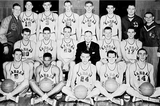 "Towering center Clyde Lovellette (right of head coach F.C. ""Phog"" Allen) made Kansas' first national championship one to remember. Lovellette became the only player to lead the nation in scoring while also playing on a title-winning team."