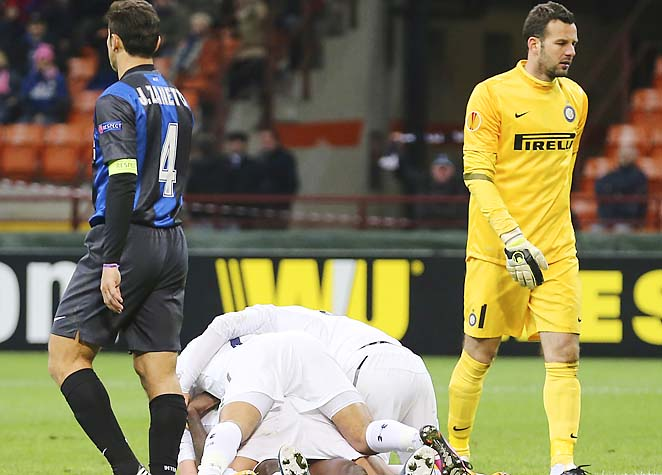 Spurs players celebrate among dejected Inter MIlan players, including captain Javier Zanetti.