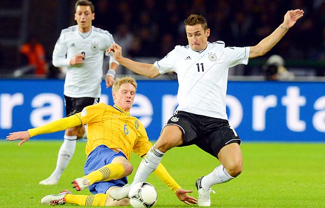 Miroslav Klose (right) is Germany's all-time leader in World Cup goals.