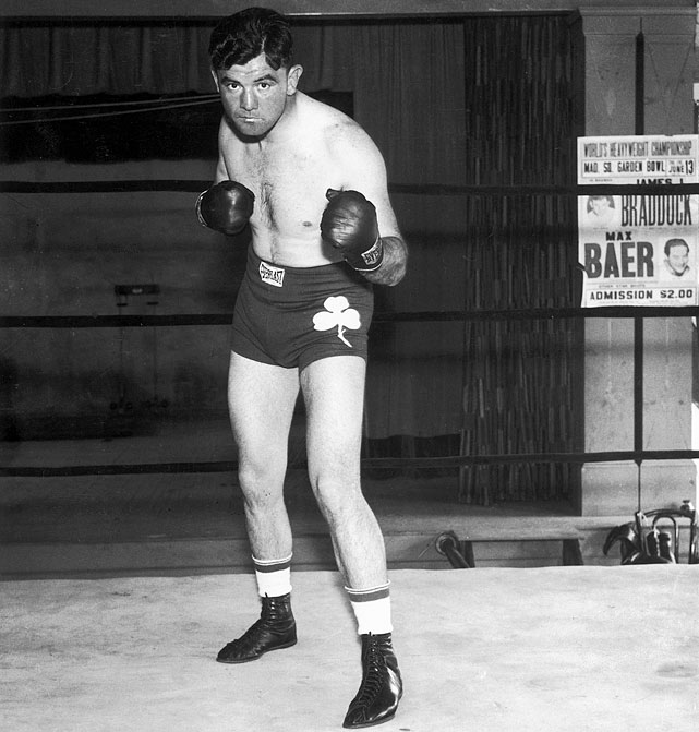 """A streak of 20 losses in 33 fights in the midst of the Great Depression forced Braddock onto welfare and into a job as a longshoreman. Braddock's boxing fortunes turned around in 1934 as he embarked on a remarkable comeback, stunning Max Baer in June 1935 to win the world heavyweight title in a unanimous decision. His incredible turnaround was captured in the 2005 film """"Cinderella Man."""""""