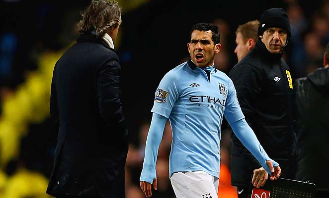 Roberto Mancini (left), Carlos Tevez and Manchester City are in second place in the Premier League.