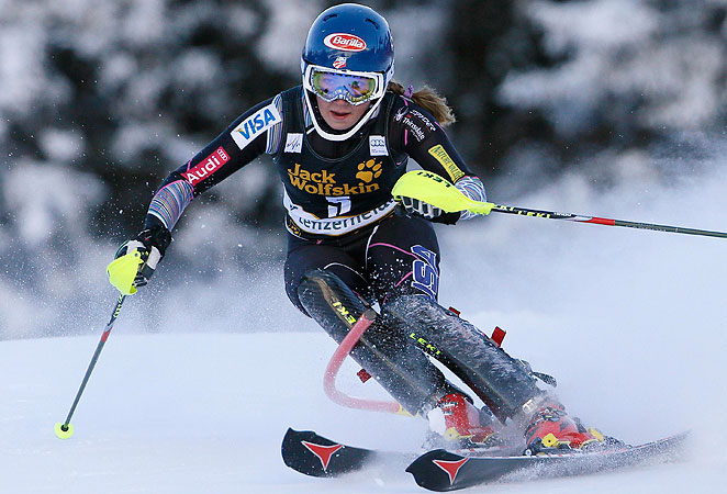 Mikaela Shiffrin's blazing second run secured the World Cup title in slalom for the 18-year-old.