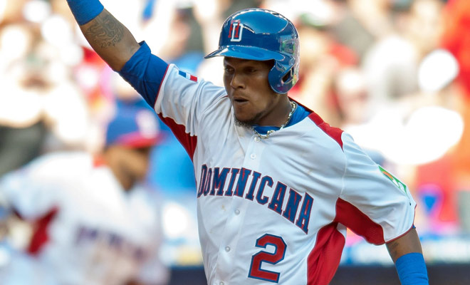 Erick Aybar celebrates after scoring against Puerto Rico in the eighth inning.