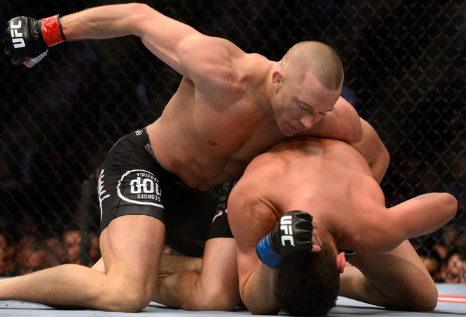 In five rounds, Georges St-Pierre (top) easily dispatched of Nick Diaz in a UFC welterweight fight.
