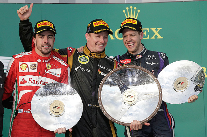 Kimi Raikkonen (center) took the season opener over Fernando Alonso (left) and Sebastian Vettel.