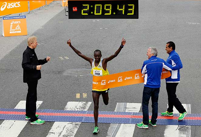 Kenya's Erick Mose crosses the finish line of the Los Angeles Marathon to win the men's race.