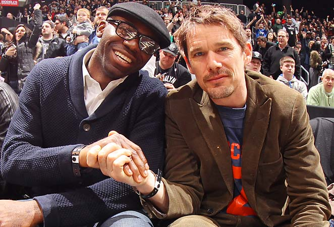 Fabrice Muamba and actor Ethan Hawke attend a recent Brooklyn Nets game.