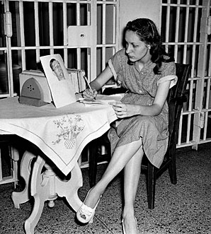 Ruth Ann Steinhagen, shown in prison in 1949 with a picture of Eddie Waitkus on the table.