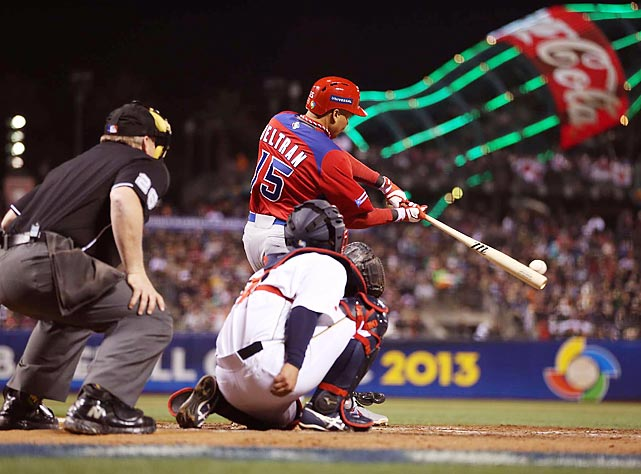 Carlos Beltran connects on a pitch in Puerto Rico's World Baseball Classic semifinal against Japan on March 17. Puerto Rico upset two-time depending champion Japan 3-1 to earn its first berth in the championship game.