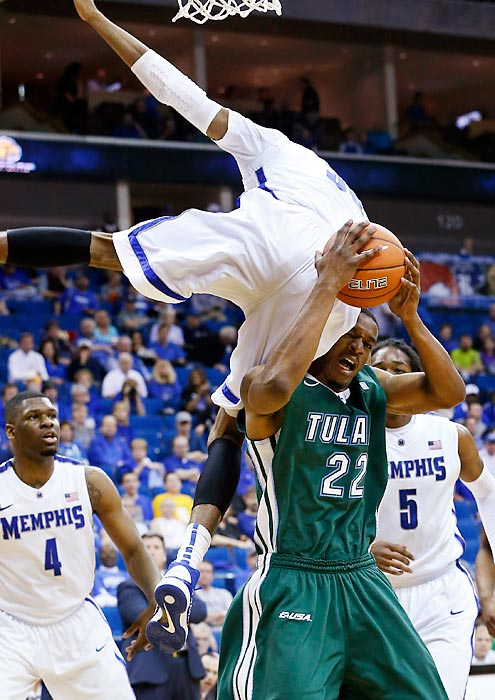 Memphis forward D.J. Stephens falls on Tulane forward Kendall Timmons in the second half of the Conference USA quarterfinals on March 14. Stephens' Tigers defeated the Green Wave 81-68 and went on to win the conference tournament and earn a No. 6 seed in the NCAA Tournament.