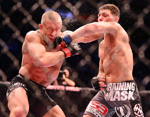 Nick Diaz lands a blow to Georges St-Pierre in their bout at UFC 158. Although Diaz connected on this punch, the welterweight champion St-Pierre did the bulk of the damage, winning the fight by unanimous decision after a lopsided five rounds.