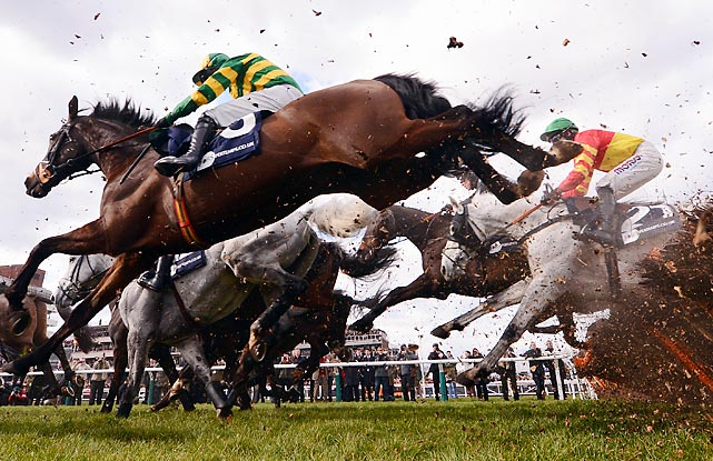 Runners and riders clear the last hurdle in the Pertempts Final at Cheltenham Racecourse on March 14 in Cheltenham, England. Richie McLernon rode Holywell to victory in the race.