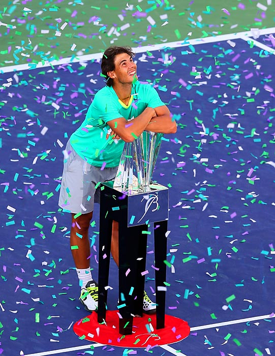 Rafael Nadal smiles and hugs his trophy as the confetti rains down on him at the Indian Wells Tennis Garden on March 17. Nadal rallied after losing the first set and trailing 1-3 in the second to defeat Juan Martin Del Potro 4-6, 6-3, 6-4 in the final at the BNP Paribas Open. The title was the Spaniard's third in four tournaments since returning from a seven-month layoff due to injury.