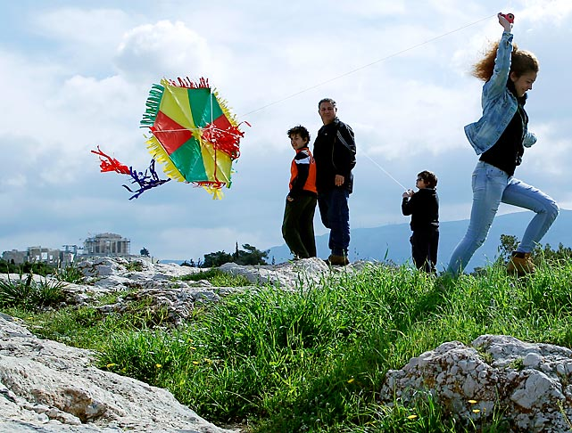 At Filopappos hill in Athens, Greeks welcome the first day of Lent by flying kites and eating foods associated with fasting -- such as air.