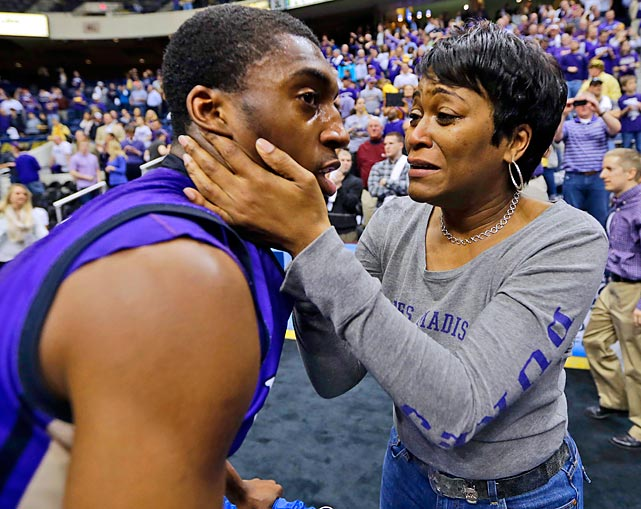 Concerned mom Lori Curry comforts her son, Taylor Bessick, after James Madison won the tourney title, 70-57, in Richmond, Va. You wouldn't know it by looking at the photo, but Taylor plays for James Madison.