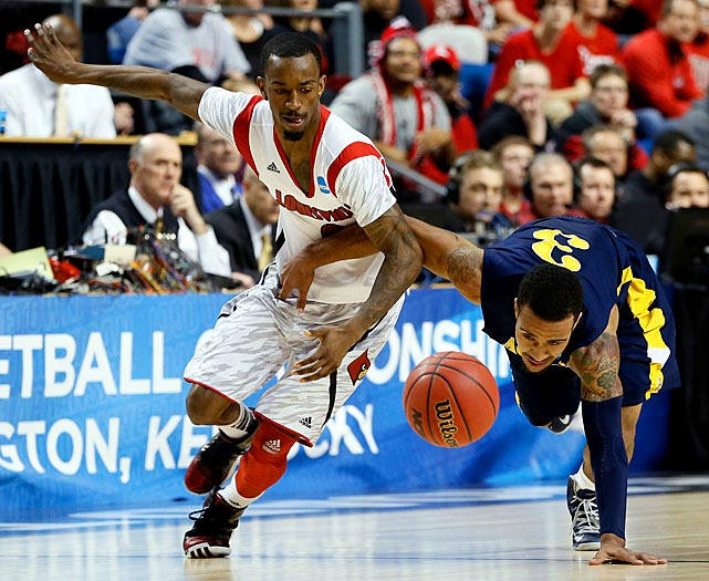 Russ Smith of top-seeded Louisville steals the ball from Jeremy Underwood during the Cardinals opening victory. Smith had a school tournament-record eight steals in the game.