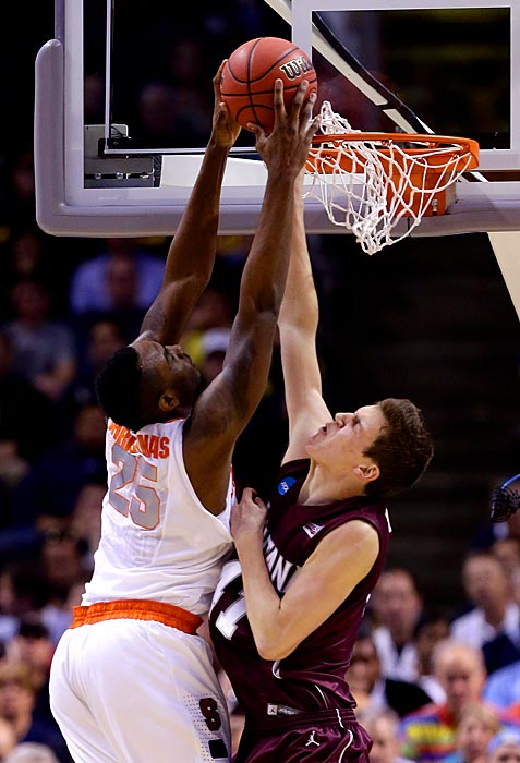 Rakeem Christmas dunks against Andy Martin in Syracuse's easy victory.