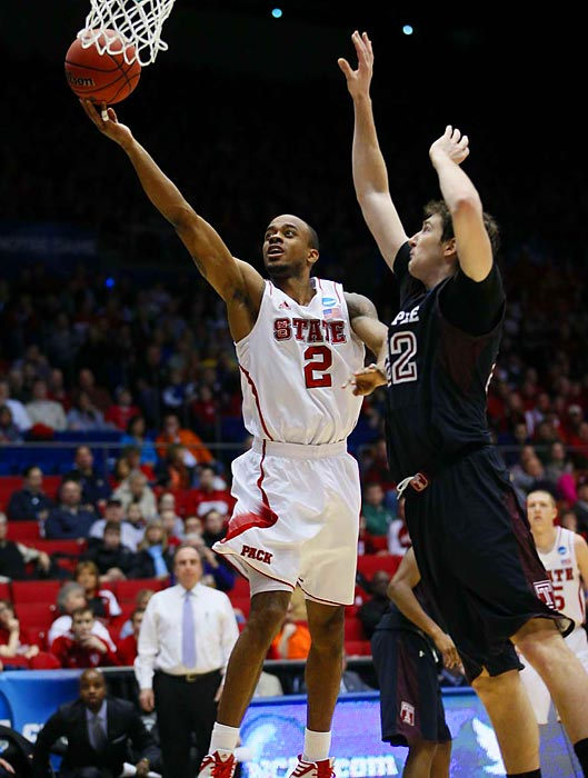 The ball rolls off the fingers of NC State guard Lorenzo Brown as Temple's Jake O'Brien tries to put him off the basket.
