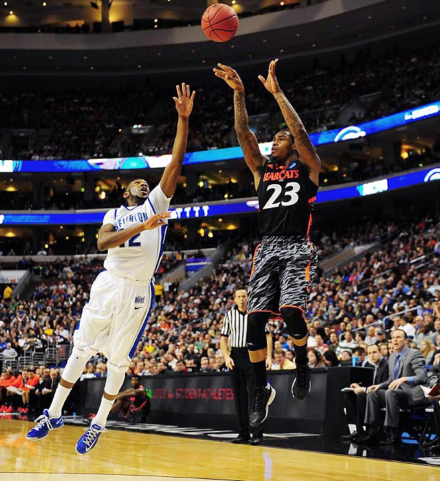 Junior guard Sean Kilpatrick, the Bearcats' leading scorer with 19 points, launches a long shot over Manigat.