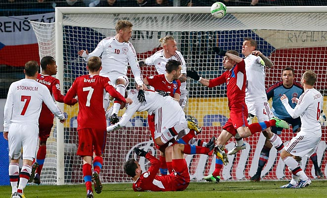 Denmark and Czech Republic players challenge for a ball during their World Cup qualifying match in Olomouc, Czech Republic on Friday.