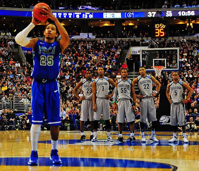 Sherwood Brown of Florida Gulf Coast, shoots a foul shot as the Georgetown Hoyas look on at the end of their loss.