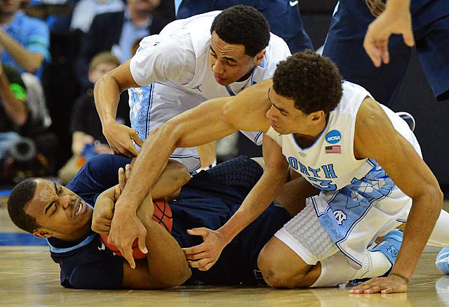 Villanova's Tony Chennault fights for a loose ball with North Carolina's James Michael McAdoo, right, and Marcus Paige, left.