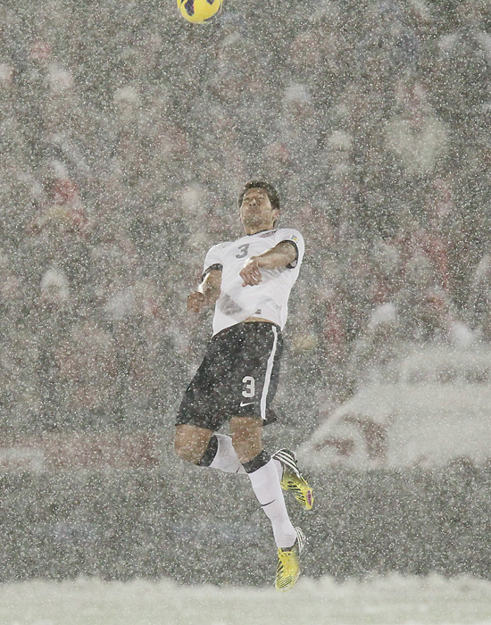Omar Gonzalez heads the yellow ball the U.S. and Costa Rica used in their World Cup qualifier as a steady snowfall made watching and playing the match a challenge.
