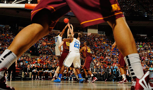 Minnesota and UCLA players contest a jump ball in their NCAA tournament game.