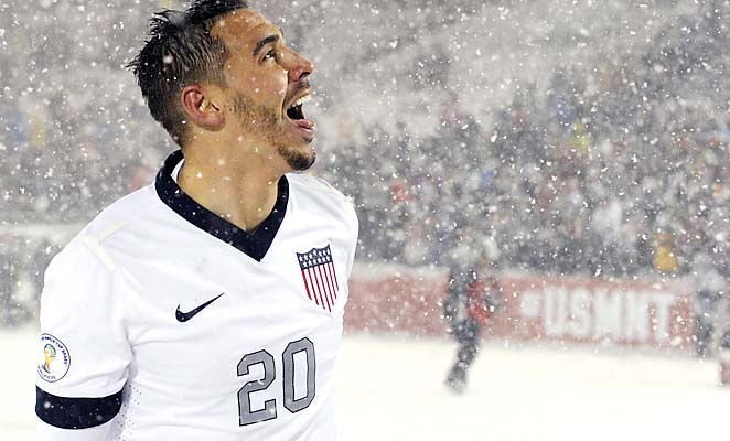 U.S. defender Geoff Cameron tries to catch snow flakes on his tongue after the victory.