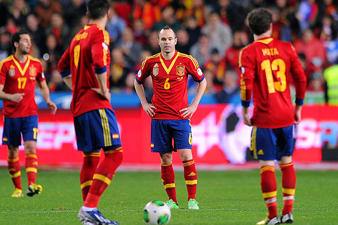 Andrés Iniesta and Spain are the defending World Cup champs. But qualifying for 2014 is no easy task.