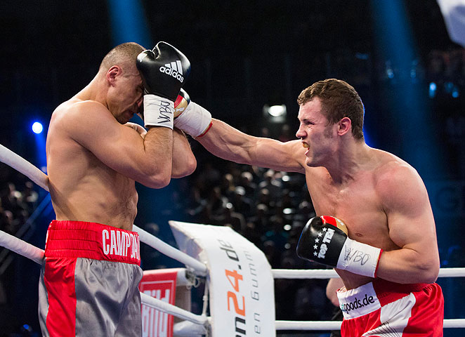 Robert Stieglitz (right) scored a technical knockout to regain his WBO super middleweight title.