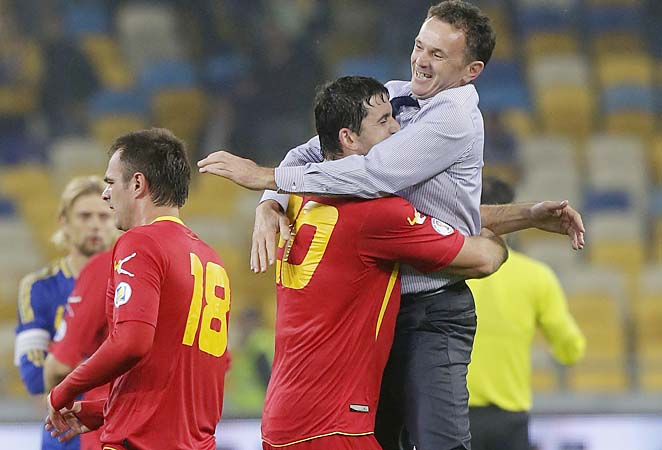 Branko Brnovic (right) and Montenegro lead their group over England in UEFA World Cup qualifying.